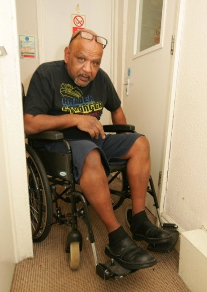 Rafee Baksh says the hostel is 'inaccessible' for him in a wheelchair.